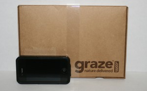 Picture of a graze.com snack box with an iphone for scale (the phone is about one sixth the size of the box)