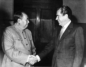 President Nixon shaking hands with Chairman Mao