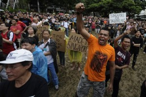 Citizens of Singapore rally against measures to increase the population.