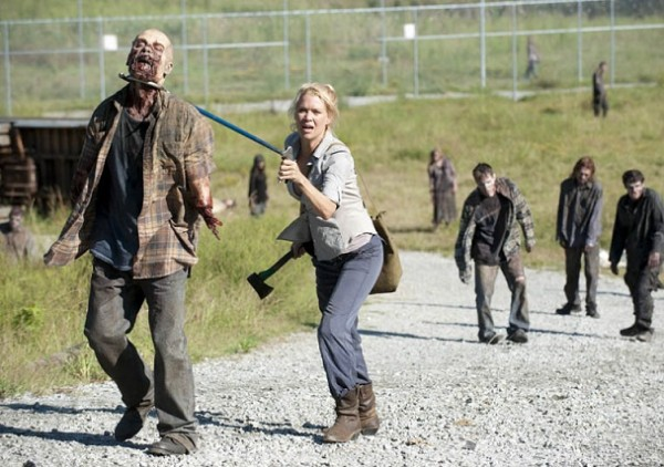 Andrea stabs a zombie through the neck