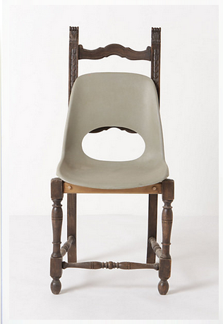 Wooden dinner chair frame with a plastic seat attached.