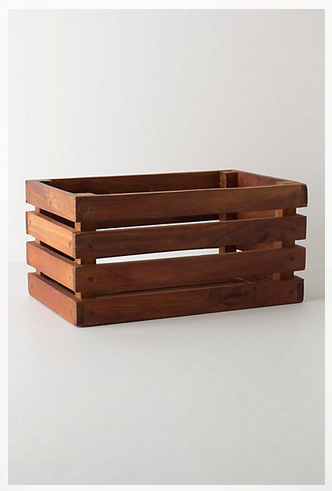 Bike basket from anthropologie. It's just a plain wooden box.