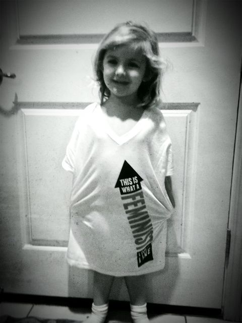 "3 year old girl, Charlie, wearing a ""This is What a Feminist Looks Like"" t-shirt"