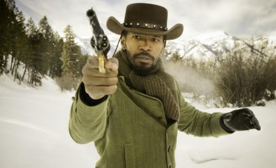 Django holding a gun