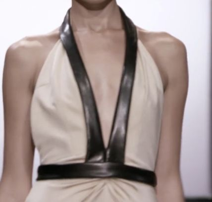 Closeup of the top of the dress with leather edging