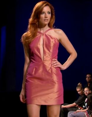Shiny pink minidress with a slit down the front