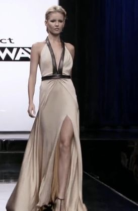 Daniel's cream colored dress with a triangular halter top edged in leather