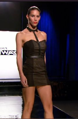 Black minidress with a single strap attached to a collar