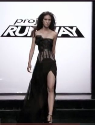 Front view of Kate and Layana' pink corset and black organza dress with a long slit up the left thigh
