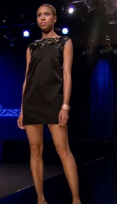 Black minidress with metal details at the neckline