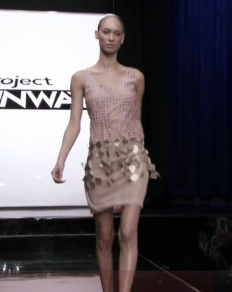 A pink dress with hand cut leather squares to create a mesh effect on the skirt