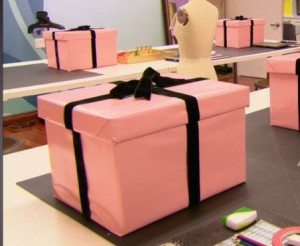 Pink boxes wrapped in black ribbon