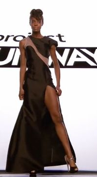 Long black dress with a slit up one thigh and a diagonal mesh panel across the bodice