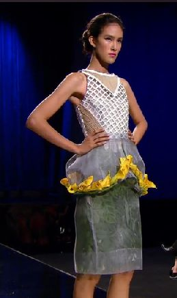 Dress with a structured bodice, a poof over the hips edged in yellow, and a gray pencil skirt