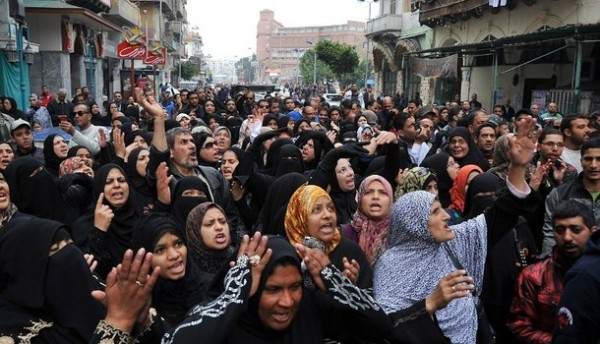 A large group of Egyptian women protesting in the streets