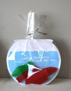 "Card shaped like a fish bowl with the message ""You're the only fish in the sea for me,"" in a plastic baggie with several Swedish Fish candies"
