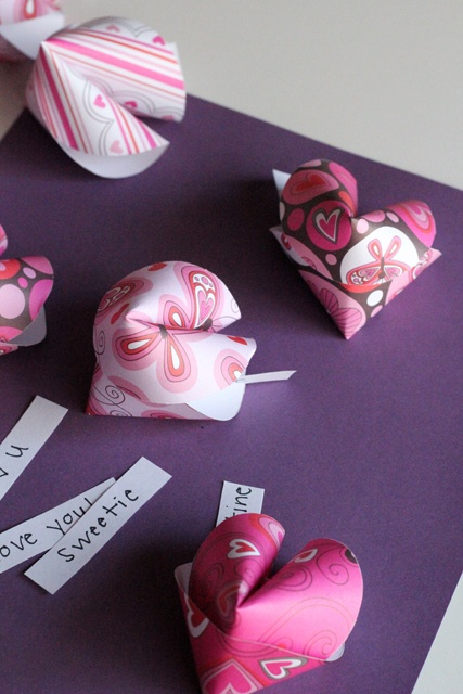 "Fortune cookies made from festive paper, with slips reading ""I love you"" and ""Sweetie"""