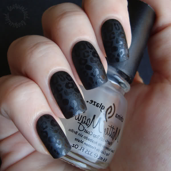 photo of hand holding China Glaze Matte Topcoat with black fingernails and a leopard print design done with the matte finish