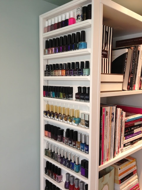 Nail polish storage shelves mounted on the side of a bookcase