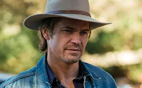 Still from Justified of Timothy Olyphant as Raylan Givens, looking tired.