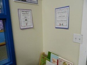 Reading corner with a bookshelf and signs explaining how to read a book and how to read with a partner