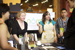 Two women demonstrate a product at Launch 2013 conference. Photo credit: Launch Conference