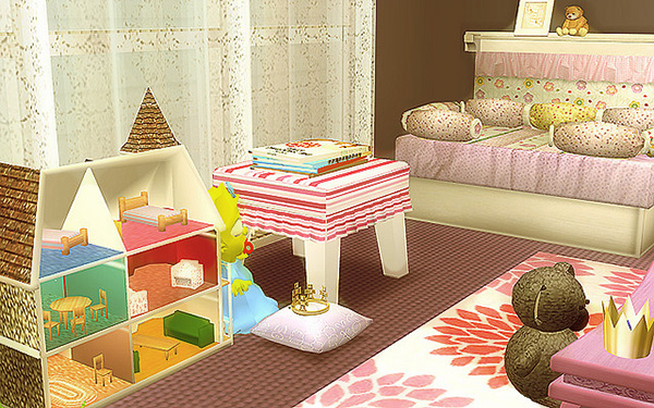 Small child's room, with a dollhouse, baby bed, and fabric covered ottoman.
