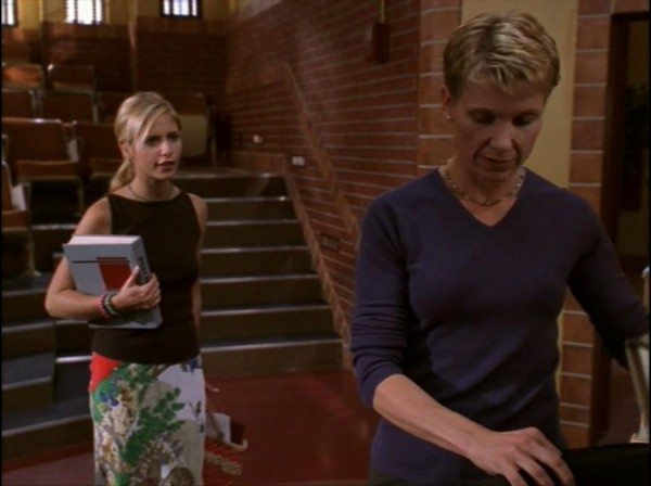 Buffy approaches Professor Walsh in the classroom