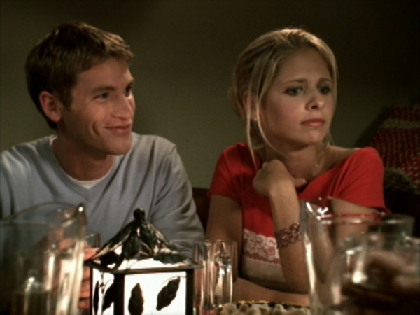 Buffy and Kip sit at a table