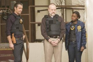 Raylan, Shelby, and Rachel in bullet-proof vests; Shelby is handcuffed