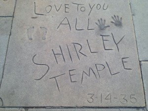 Shirley Temple's autograph, handprints, and footprints in concrete