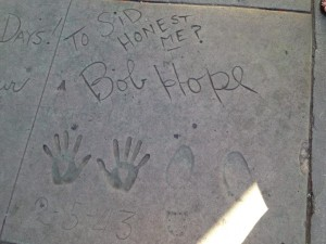 Bob Hope's autograph, handprints, and footprints in concrete with a note reading, 'To Sid, honest me?'