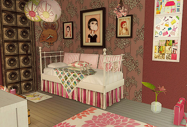 Pink room for a pre-teen child with a daybed and framed pictures on the wall.