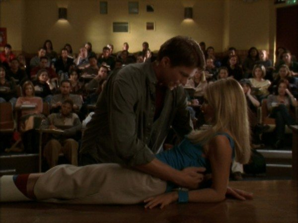 Dream sequence of Buffy and Riley about to kiss in the lecture hall