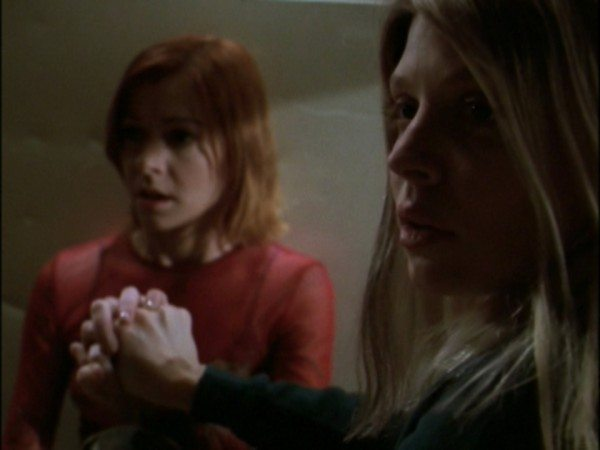 Willow and Tara join forces, holding hands to do magic together