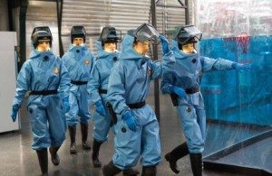 A still from the tv show Bones: the cast walk into the lab, dressed in biohazard suits.