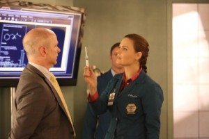 A screencap from the TV show Bones. The character of Brennan threatens another character with a needle.