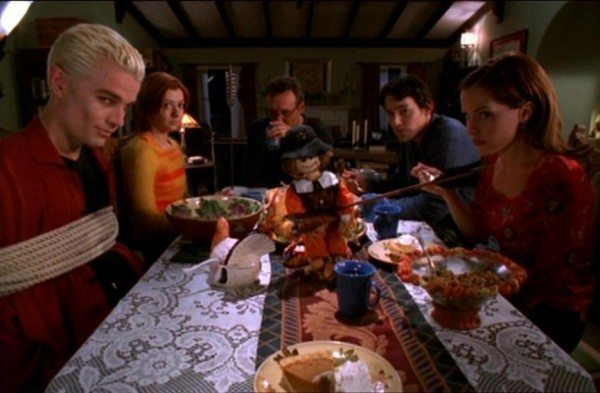 The gang sits down to Thanksgiving dinner