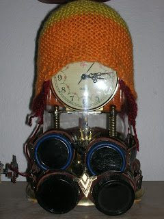 Jayne hat atop an antique clock and steampunk goggles