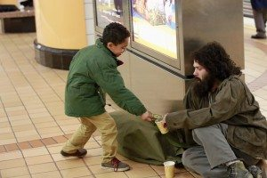 Huck panhandles in the subway, a young boy (his son) gives him some coins