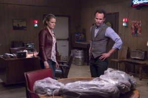 Boyd and Ava and a dead body wrapped in plastic