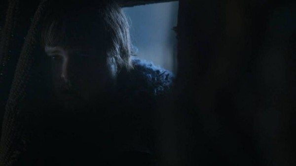 Sam peers through the door to watch Gilly give birth