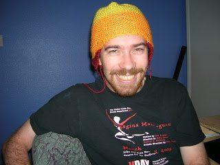 "Wash wearing handmade orange ""Jayne"" hat"