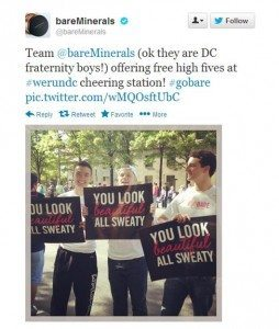 "Screencap of a tweet reading ""Team BareMinerals (ok they are DC fraternity boys!) offering free high fives at #werundc cheering station. #gobare"" and a picture of three men holding signs that read ""You look beautiful all sweaty."""