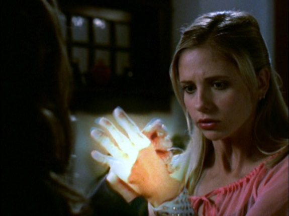 Buffy and Faith's interlocked hands glow