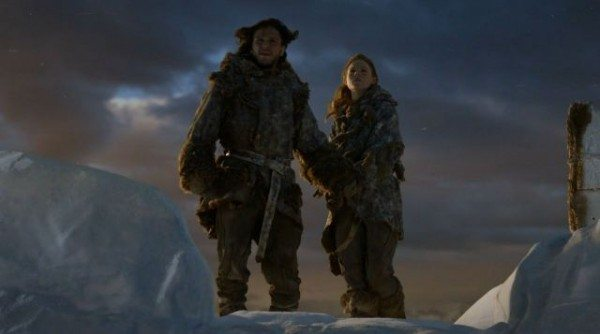 Jon and Ygritte stand on the edge of the Wall at sunset