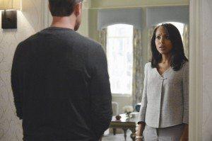 Olivia opens the door to find Jake guarding her