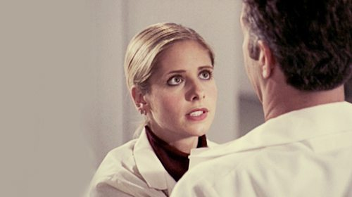Buffy undercover, wearing a lab coat