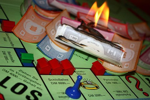 Monopoly board on fire.