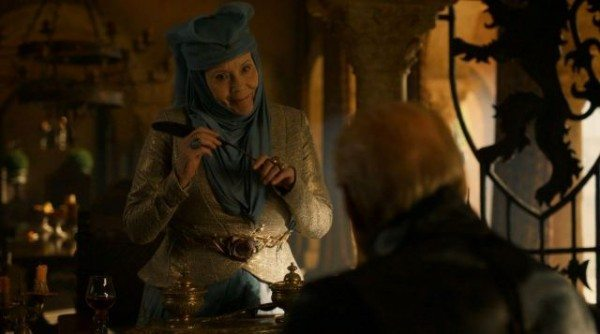 Olenna smiles at Tywin while snapping his quill